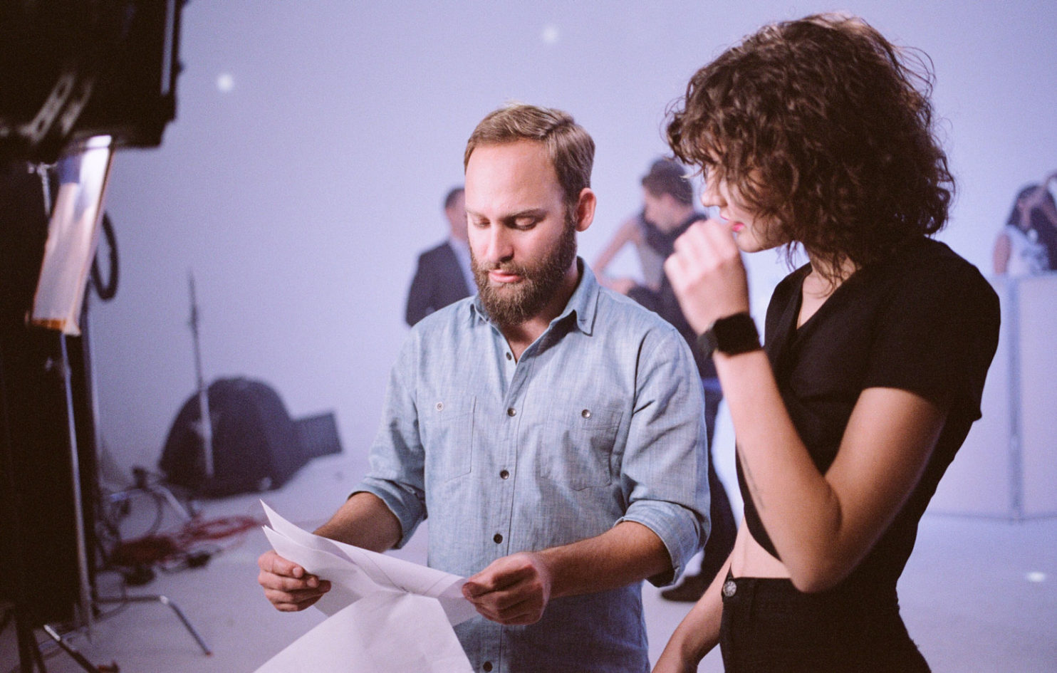 A Byline Video Producer consults with an actress / model on-set in the studio