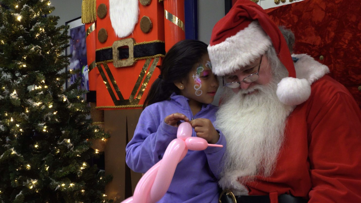 Little girl tells Santa what she wants for Christmas - screen grab from event video coverage for Chevrolet